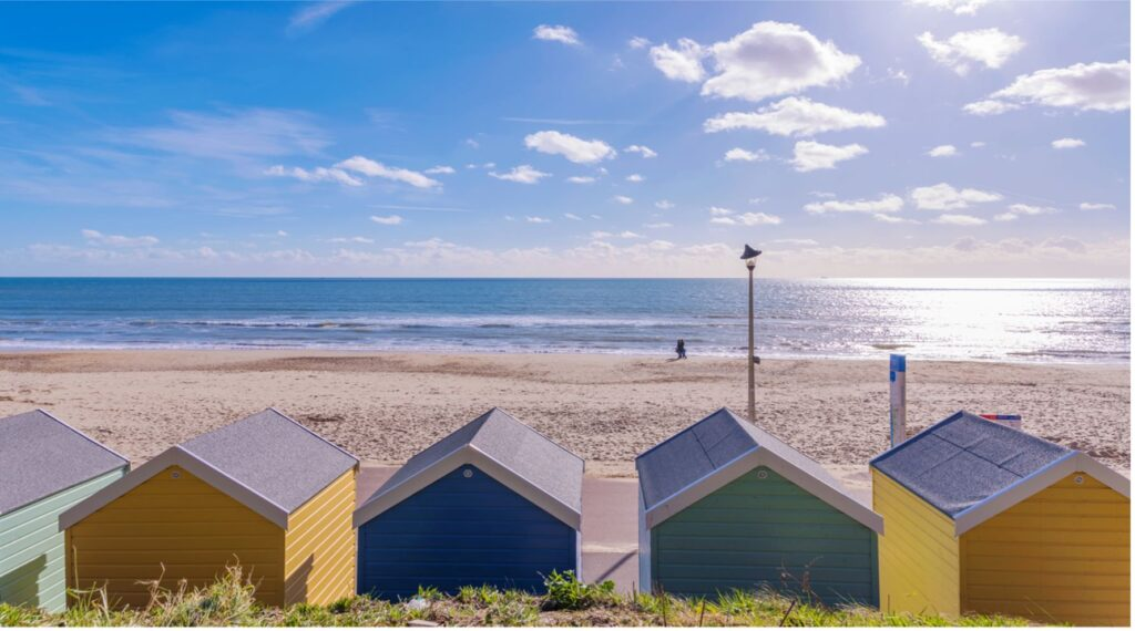 Image of Beach Huts in front of the sand